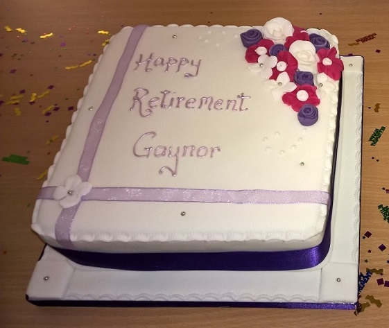 """Happy Retirement"" cake presented by work colleagues"